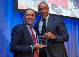 Mark Tatum receives award from John Starks.