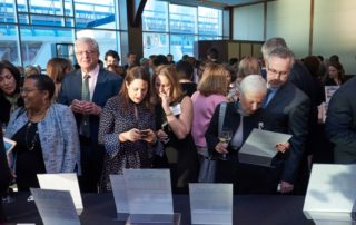 Gala guests consider silent auction items.