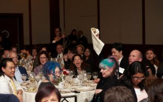 Gala guests bid in the auction.