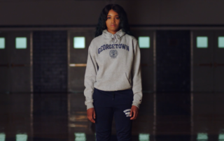 Mariama Barry, in a Georgetown sweater, looks at the camera