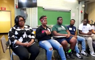 A college student gives advice on campus life at the alumni panel.