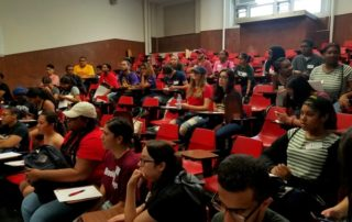 Students listen attentively at the alumni panel.