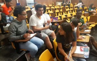 Students tackle a worksheet during a workshop.