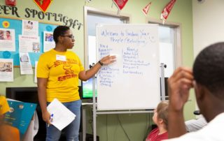 "A Let's Get Ready staff member runs a ""Finding your people/Belonging"" workshop as students look on."