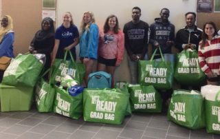 Students at the Maine Transition Day pose with their Grad Bag supplies.