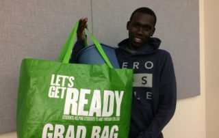 A student shows his Grad Bag to the camera.
